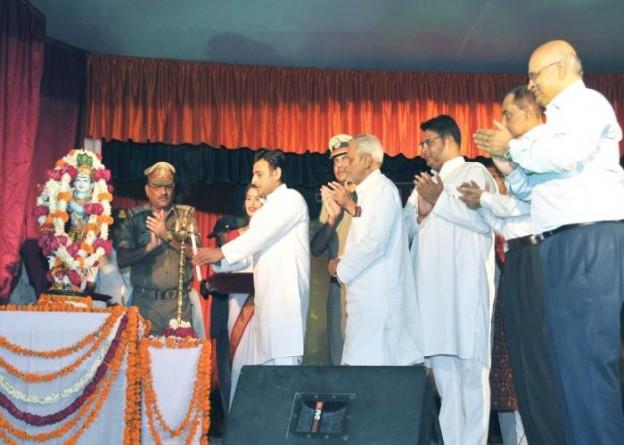 Uttar Pradesh Chief Minister Akhilesh Yadav garlands an idol of lord Krishna on Janmashtami at police lines in Lucknow